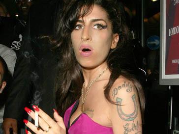 Эми Уайнхаус (Amy Winehouse) прилетела в Москву