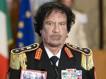 Муамара Каддафи (Muammar Kaddafi) пообещал разобраться с повстанцами.