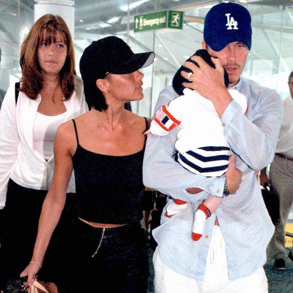 Виктория и Дэвид с Бруклином на руках (1999)