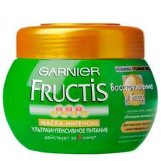 Маска-интенсив Garnier Fructis с маслом оливы, авокадо и карите. Обеспечивает питание и восстановление волос. Действует за 5 минут.