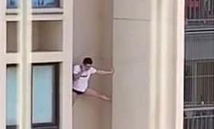 видео повисшим стене небоскреба разговаривающим телефону мужчиной вирусным