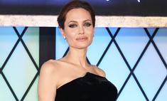 Деловой стиль: Джоли на ковровой дорожке и в жизни