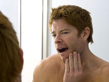 Заболевание зубов ведет к импотенции