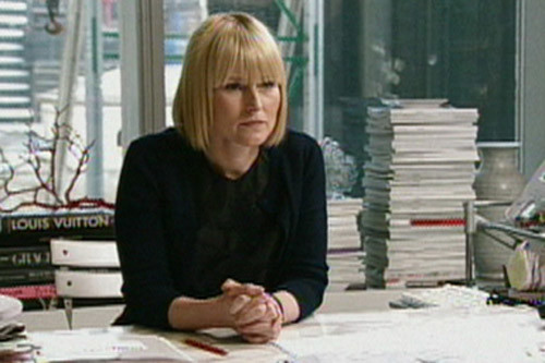 Эми Эстли у себя в кабинете.