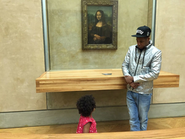 Джей Зи с дочкой на фоне Моны Лизы