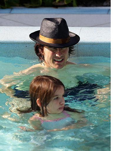 Том Круз (Tom Cruise) с дочкой Сури (Suri)