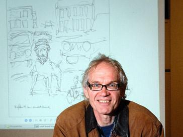 Ларс Вилкс (Lars Vilks) на фоне своей карикатуры