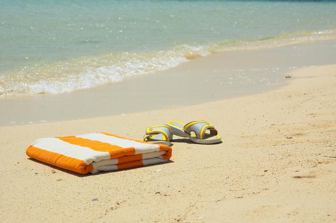 Желто-полосатое пляжное полотенце - главный символ курортного Египта