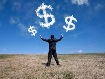 Облака-доллары и бизнесмен