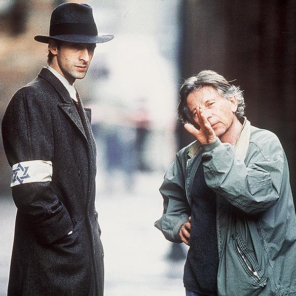 С актером Адрианом Броуди на съемках фильма «Пианист», в котором Полански рассказал о пережитых ужасах в гетто.