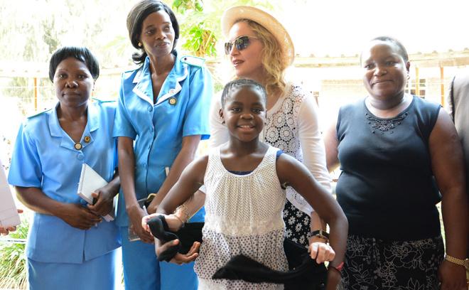 Мадонна и ее приемные дети