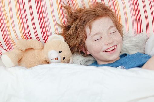 что значит смеяться во сне