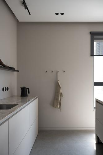 Фото №5 - Минималистская квартира в доме с радиусной планировкой