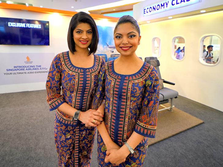 Фото №13 - Небо, самолет, девушка: самые красивые униформы стюардесс в мире