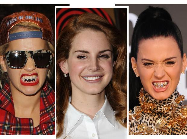 Фото №1 - Стразы, грилзы и клыки вампира: самые странные зубные «украшения» звезд