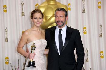 Дженнифер Лоуренс (Jennifer Lawrence ) и Жан Дюжарден (Jean Dujardin) на церемонии вручения премии «Оскар», 24.02.13