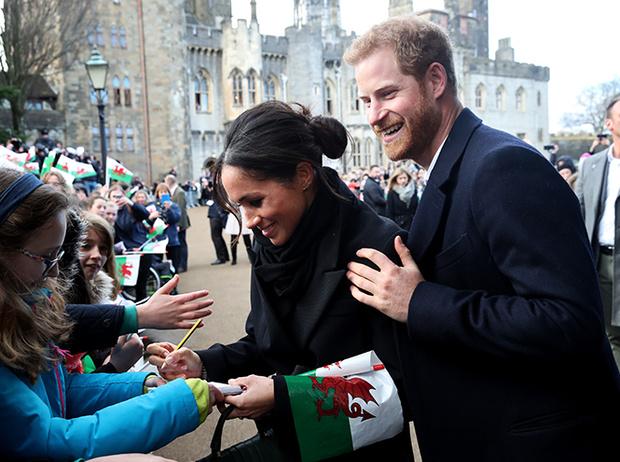 Фото №15 - Принц Гарри и Меган Маркл впервые посетили столицу Уэльса