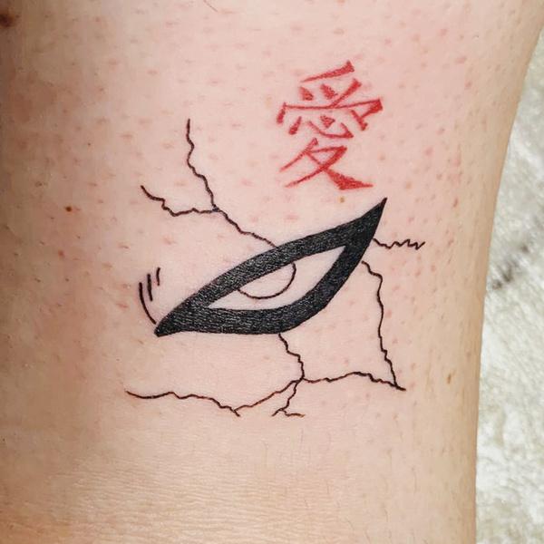 Фото №9 - «Наруто»: 9 тематических татуировок, которые поймут только тру фанаты