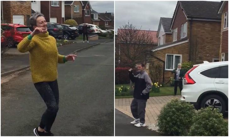 Фото №1 - Видео с соседями, которые каждое утро выходят из карантина на улицу и танцуют на дистанции друг от друга, стало вирусным