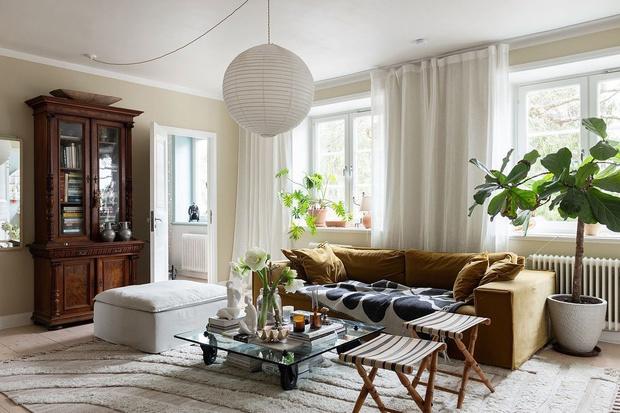 Фото №4 - Гостиная в скандинавском стиле: советы по декору и оформлению