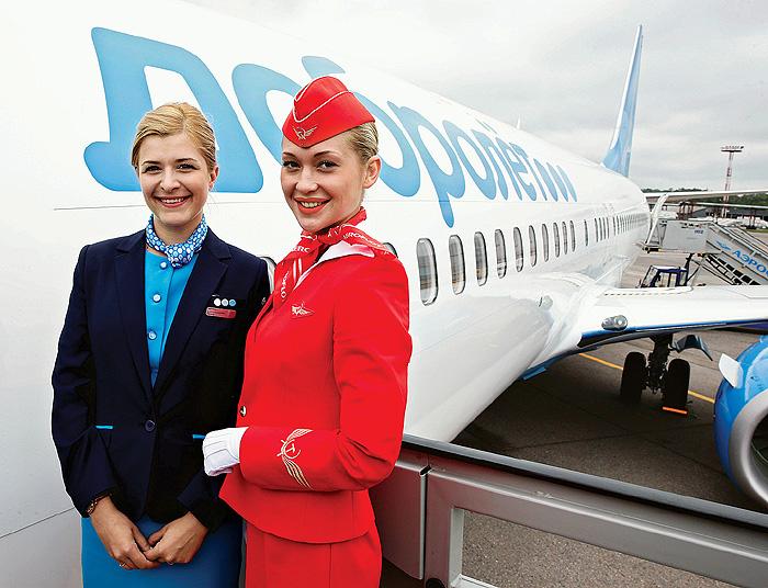 Фото №8 - Высокие стандарты: стюардессы из разных стран мира