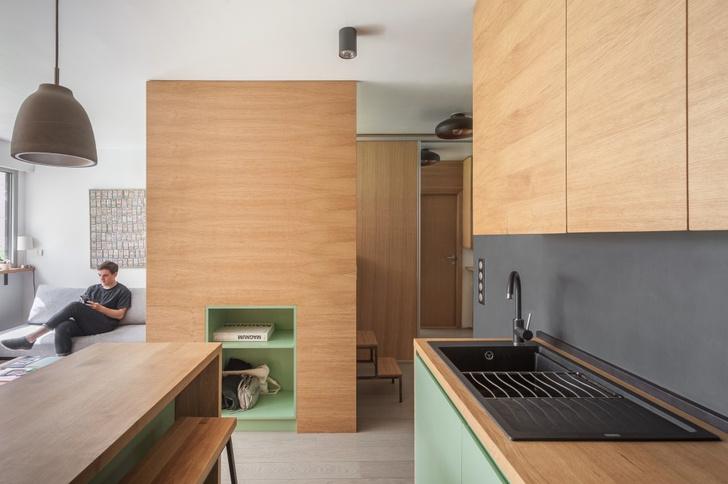 Фото №7 - Маленькая студия 30 м² со встроенной мебелью в Париже