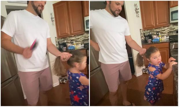 Фото №1 - Девочка излишне драматизирует, пока отец «расчесывает» ей волосы (видео)