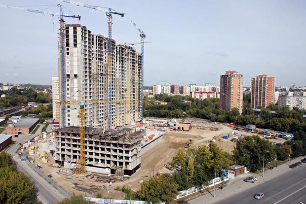 Фото №1 - Минстрой хочет увеличить количество российских рабочих на стройках