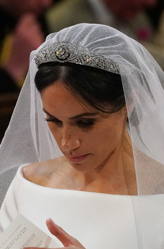 Фото №4 - Как королева намекнула на связь с Меган на свадьбе