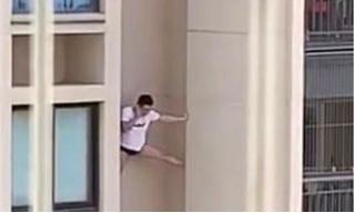Видео с повисшим на стене небоскреба и разговаривающим по телефону мужчиной стало вирусным