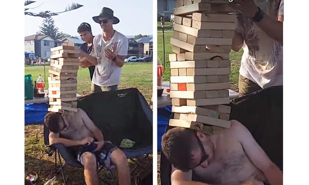 Фото №1 - Шутники построили на голове спящего во хмелю приятеля башню из досок (видео)