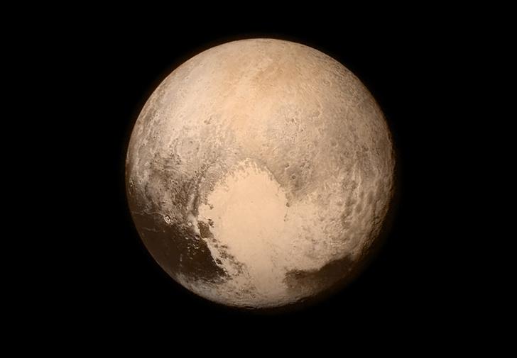 Фото №1 - Открытия New Horizons: ледяная гора на Плутоне и «Мордор» на Хароне