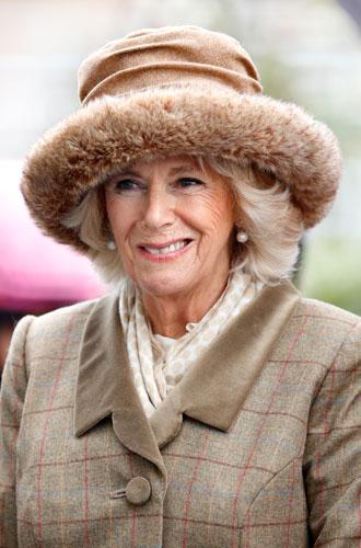 Фото №9 - От Королевы до герцогини Кейт: как королевские особы носят мех