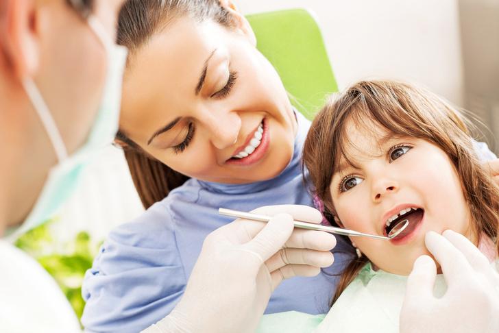 Почему темнеют зубы у ребенка