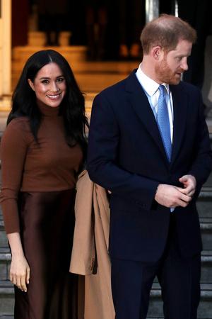 Фото №14 - Их модные Высочества: лучшие парные образы Меган и Гарри