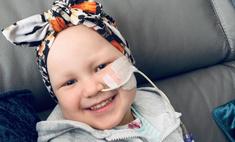 До слез: больная раком девочка целует папу через стекло