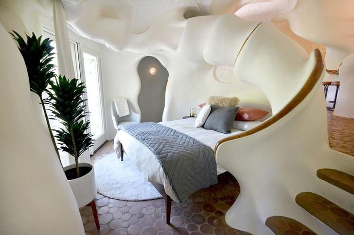 Фото №10 - Сказочный дом с органическими формами в сердце леса