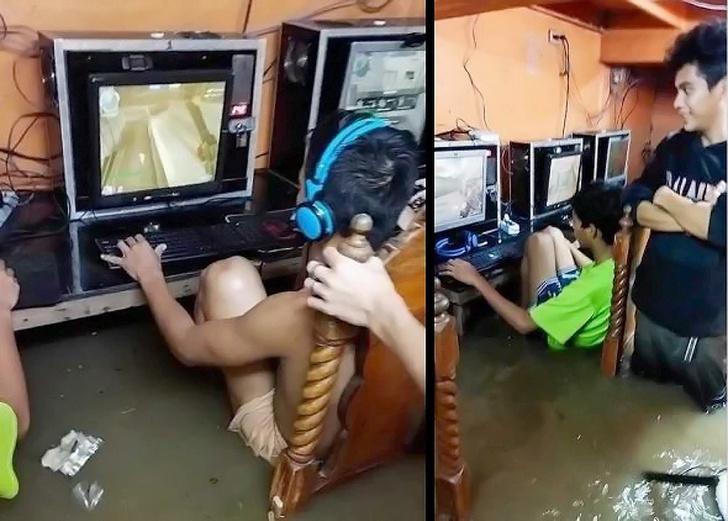 Фото №1 - Безумная храбрая молодежь не бросает играть на компьютере во время потопа (фото и видео)