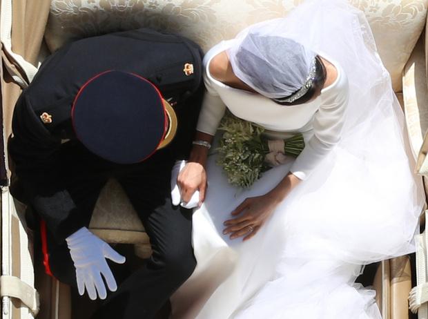 Фото №1 - Как был сделан самый известный свадебный снимок принца Гарри и Меган Маркл