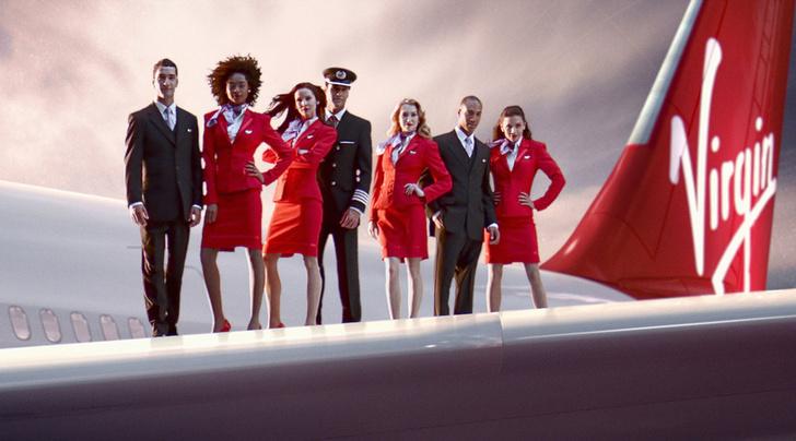 Фото №11 - Небо, самолет, девушка: самые красивые униформы стюардесс в мире