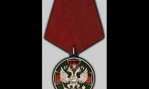 Фото №1 - За борьбу с Эболой президент наградил сотрудников Роспотребнадзора медалями и орденами