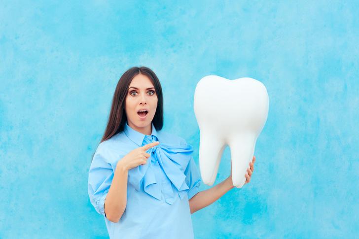 Фото №1 - Стоматолог удалил пациенту самый длинный в истории зуб