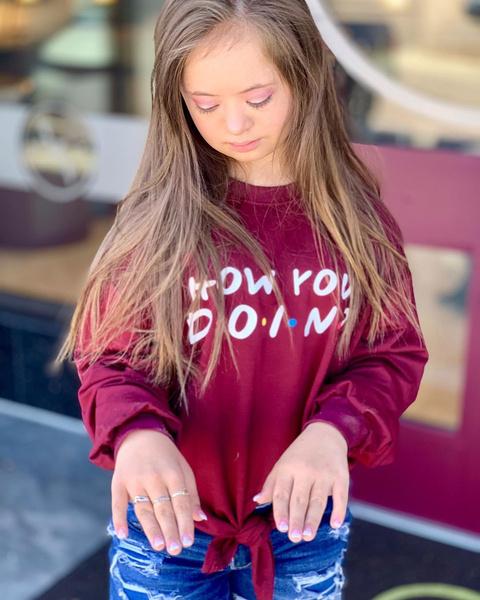 Фото №1 - Девочка с лейкемией и синдромом Дауна стала моделью: фото