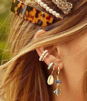 Фото №14 - 5 стильных способов носить каффы на ухо