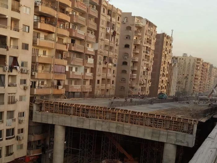 Фото №1 - В Каире строят эстакаду впритык к жилым домам